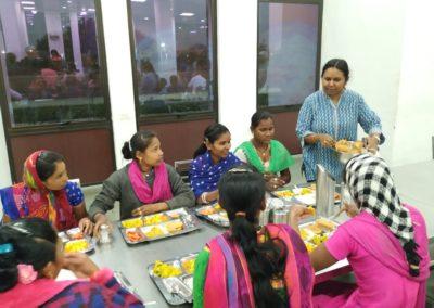 Prof Sivapriya serving meal