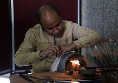 A glass beads artist from Varanasi giving a demo