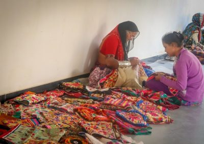 Artists showing glass workings in traditional attires